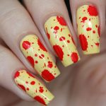 Рисунок на ногтях красного и желтого цвета