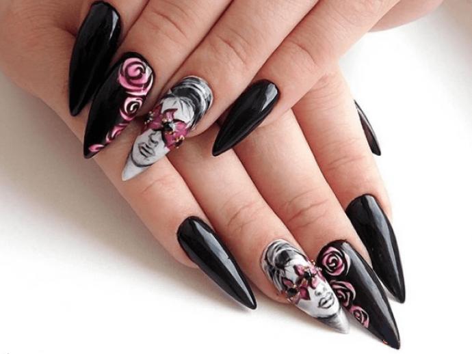 Маникюр черного цвета для длинных заостренных ногтей