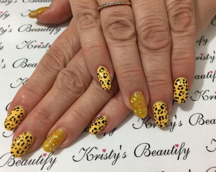 Леопардовый желто-черный маникюр