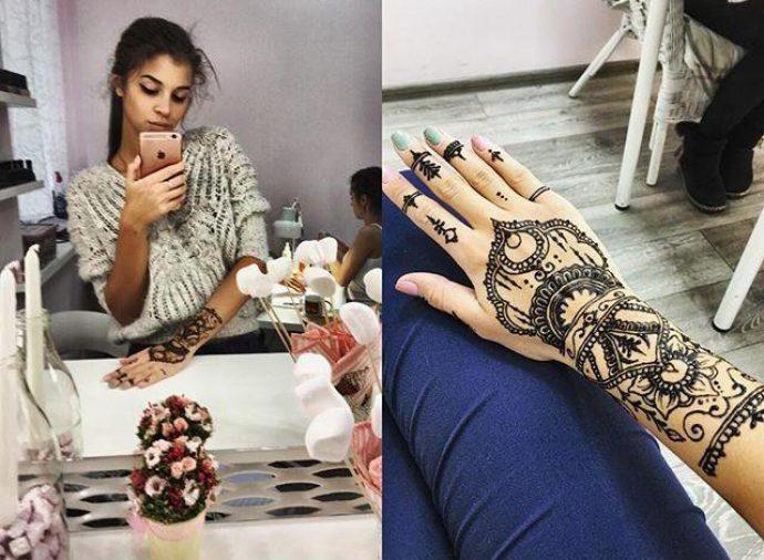 Алиана Гобозова с маникюров в сдержанных тонах и татуировкой мехенде
