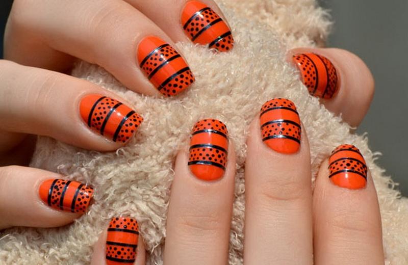 Оранжевый с чёрным: варианты яркого маникюра