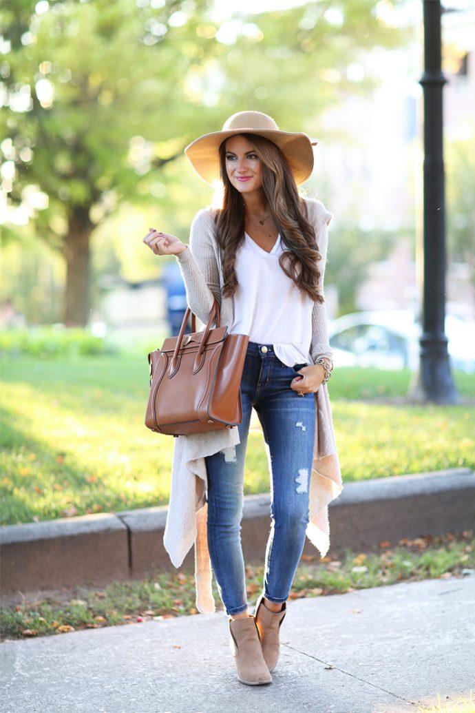 Девушка в джинсах-скинни и шляпе
