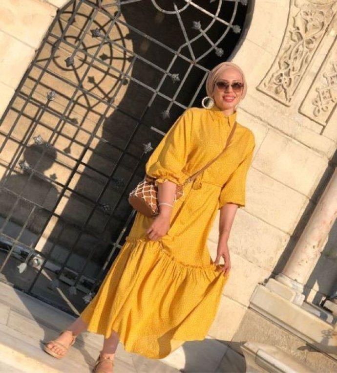 Девушка мусульманка в желтом платье