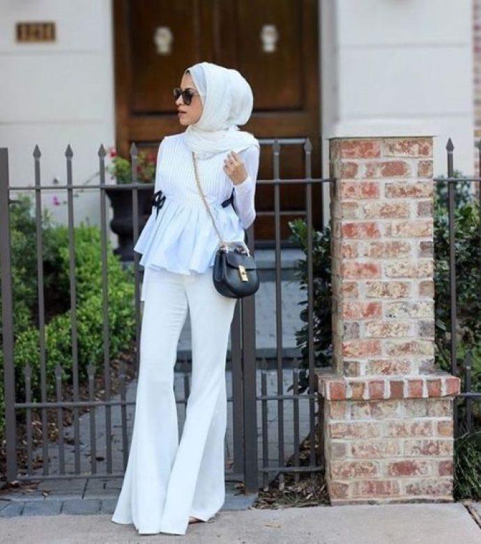 Девушка мусульманка в белом костюме